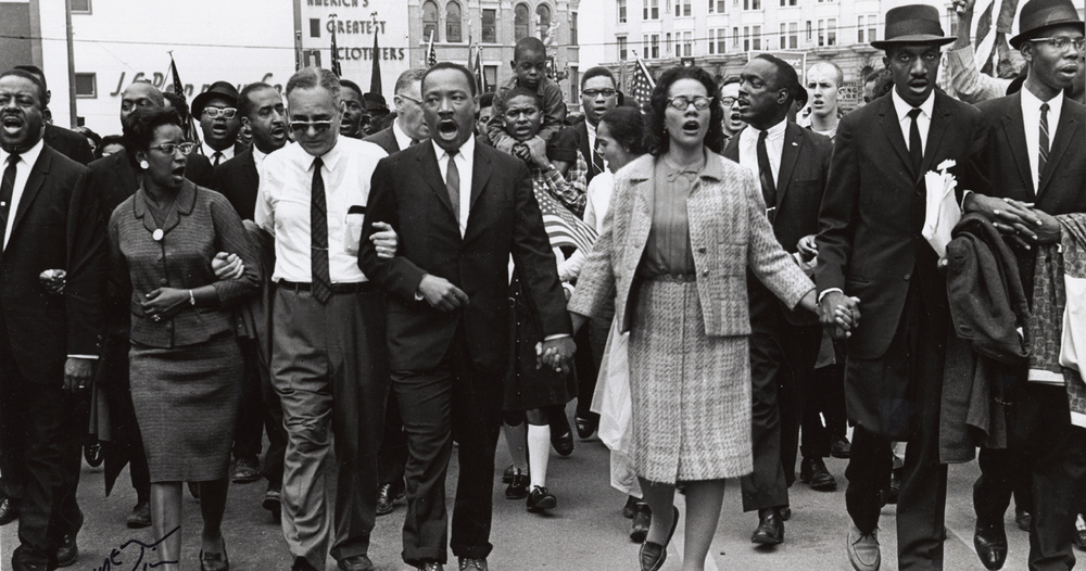 A photo of the historic Selma to Montgomery march in 1965 with Dr. Martin Luther King, Jr. and Mrs. King in the center - taken by photographer Spider Martin now displayed at The Levine Museum. For more photos from this historic event, visit the photography exhibit currently on display at The Levine Museum of the South.