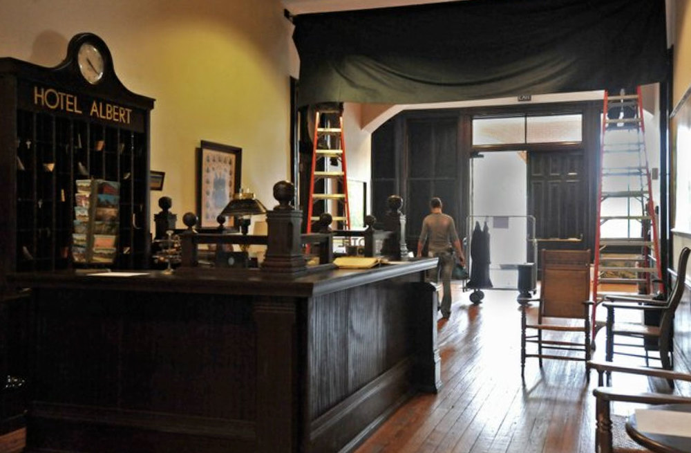 A photo of t he Rockdale County Courthouse's interior which was magically transformed into Hotel Albert for  Selma.  Image via  Google .