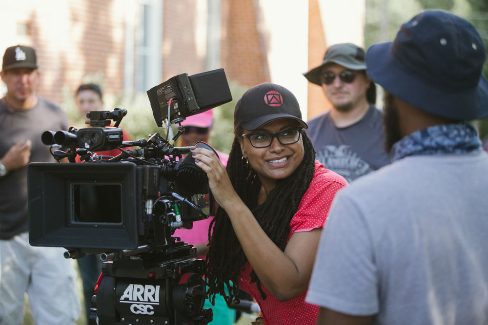 Director Ava DuVernay on the set of  Selma  - image via  Google .