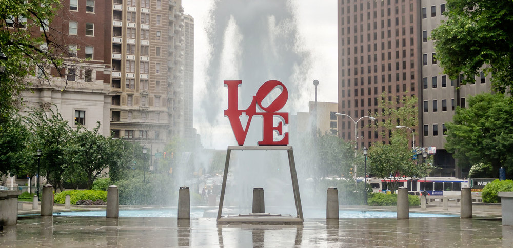 Love Park (or JFK Plaza) in downtown Philadelphia and the famous LOVE sculpture by artist Robert Indiana - image via  Google .