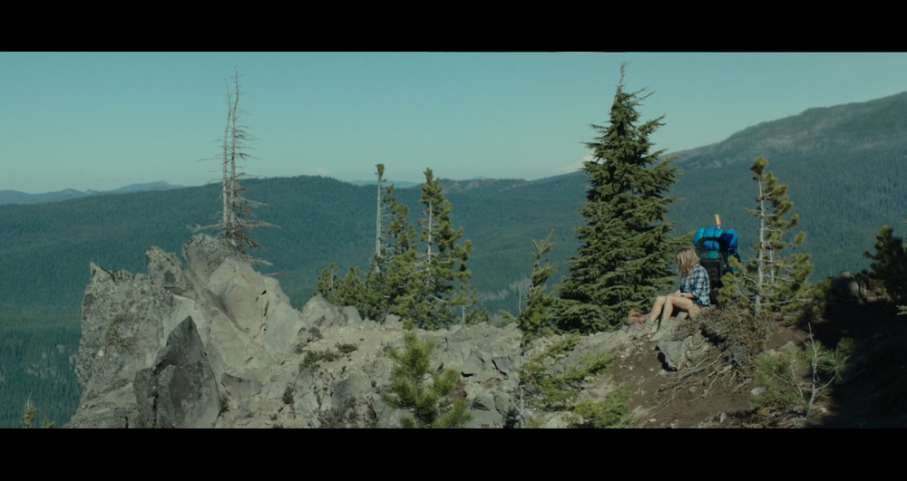 Screenshot of the famous and dramatic boot drop scene which was filmed on Mount Hood (near the Ski Bowl area).