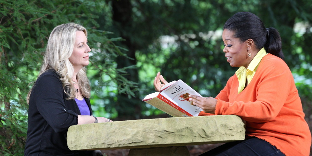 Cheryl Strayed in an interview with Oprah on her memoir Wild: From Lost to Found on The Pacific Crest Trail. Oprah relaunched her book club (Oprah's Book Club 2.0) so she could share Cheryl's story with everyone. Image via Google.