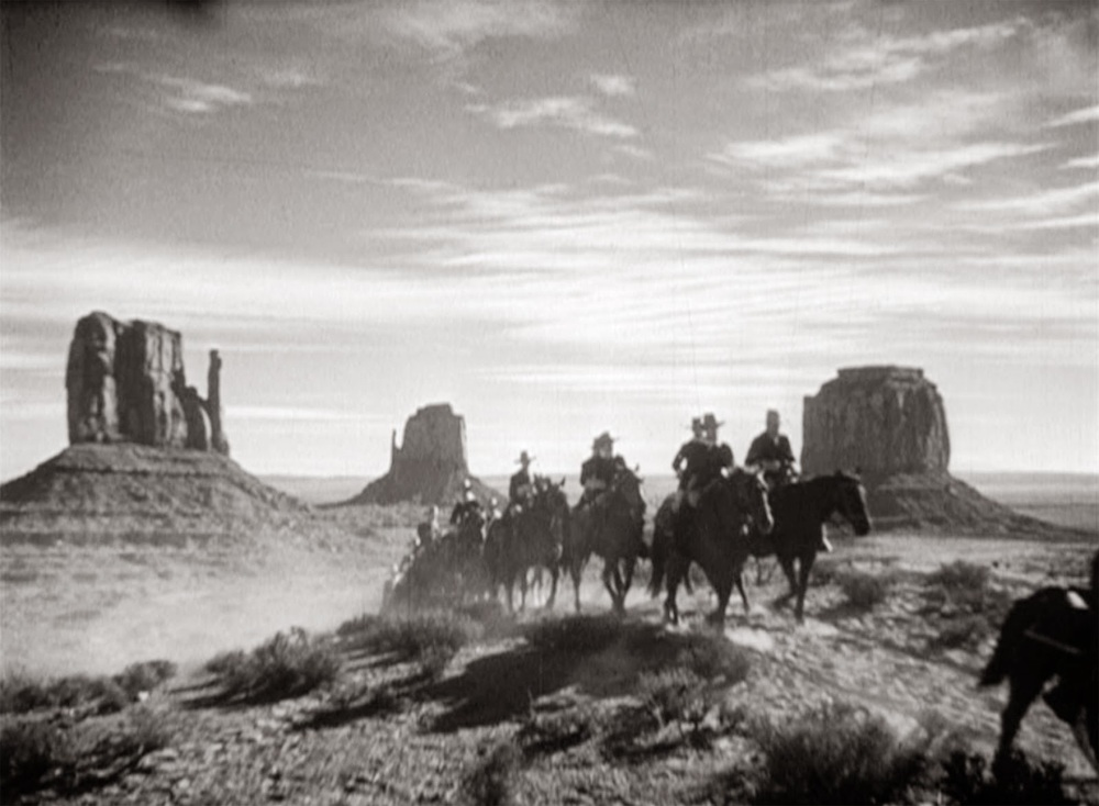 A scene from John Ford's  Stagecoach  (1939), filmed at Monument Valley - image via  Google .