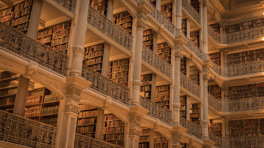 The George Peabody Library is world-famous for its beautiful five tiers of ornamental cast-iron balconies rising 61 feet above the floor (ironwork fabricated by the Bartlett-Robbins & Company).