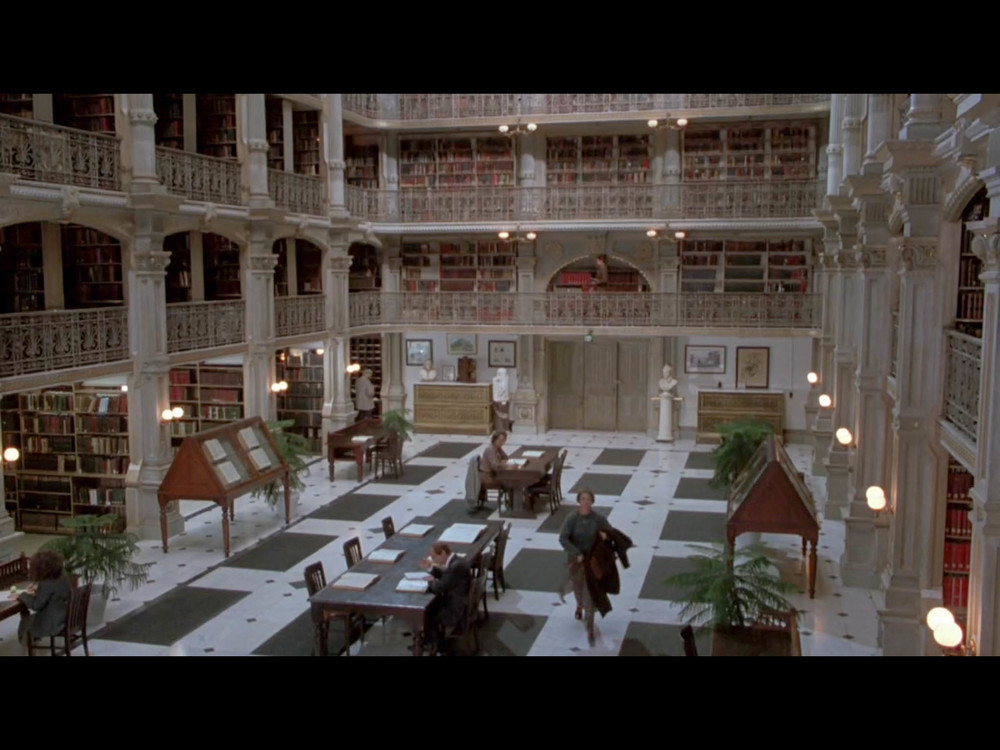 Screenshot from Sleepless In Seattle of Annie walking through her brother's office building - filmed on location at the George Peabody Library.