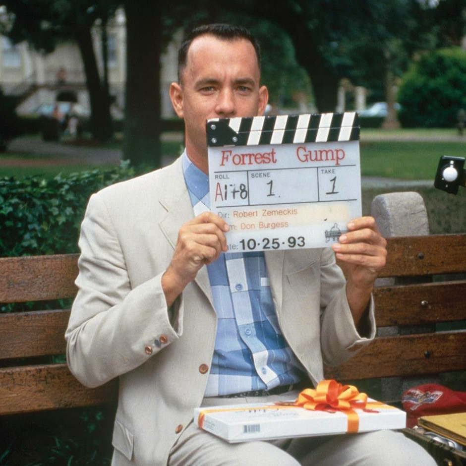 Tom Hanks on the famous bench from the Savannah film set of Forrest Gump - image via Google).