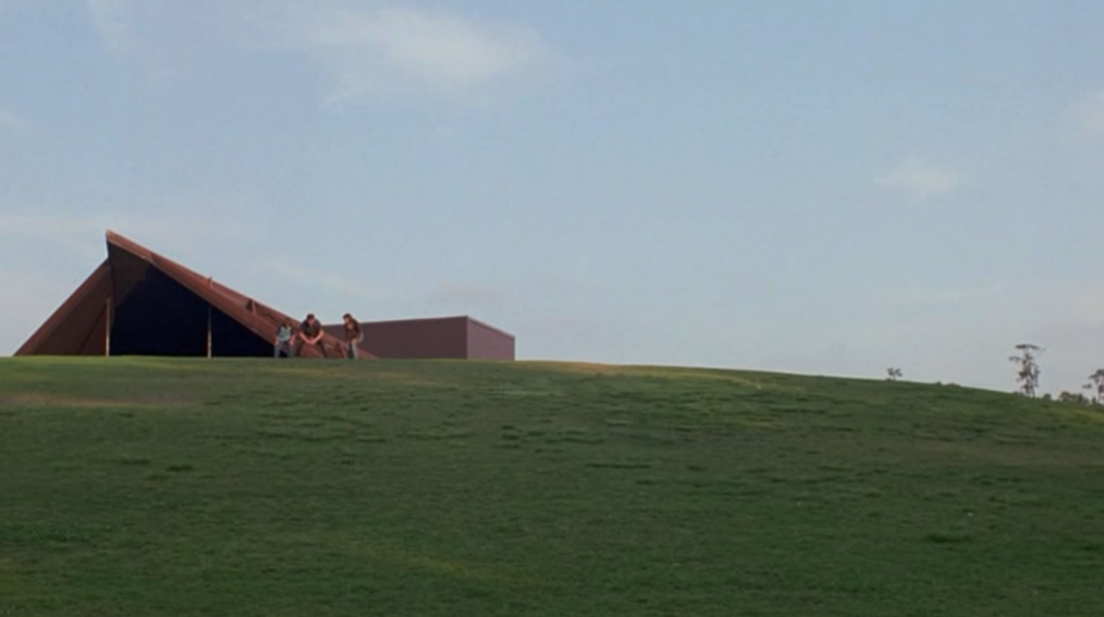 Screenshot from Boyhood of a scene shot at the Miller Outdoor Theater in Houston where Mason Sr. plays football with his kids.