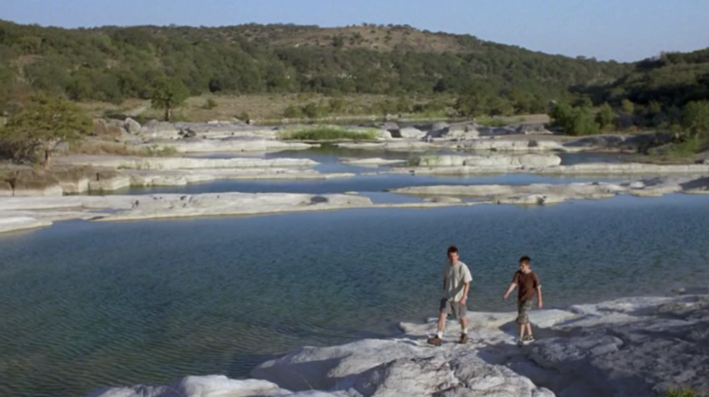 Screenshot from Boyhood of a scene filmed at Pedernales Falls State Park with Mason Sr. and Mason Jr. as they go on a hike in the park.