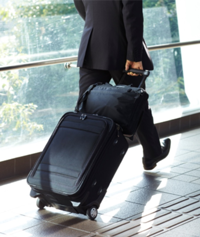 man in suit rollaboard luggage.jpg