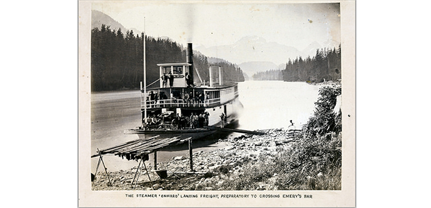 Photo: The Steamer 'Onward' landing freight, preparatory to crossing Emery's Bar, by Frederick Dally (ca. 1867). The steamer would have been carrying people and goods to gold mining sites on the Fraser River.