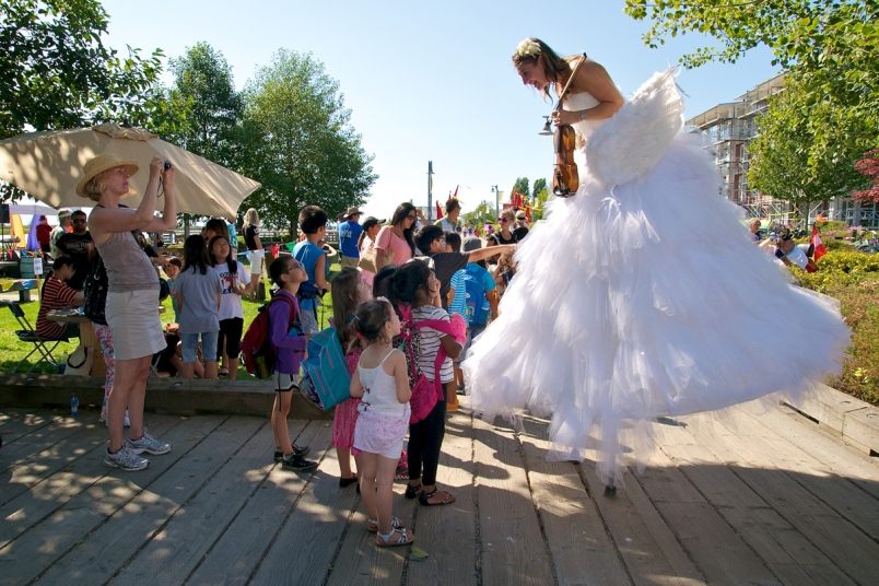 A fiddle Fairy from the ocean greets kids on the boardwalk. | Image: Richmond Maritime Festival