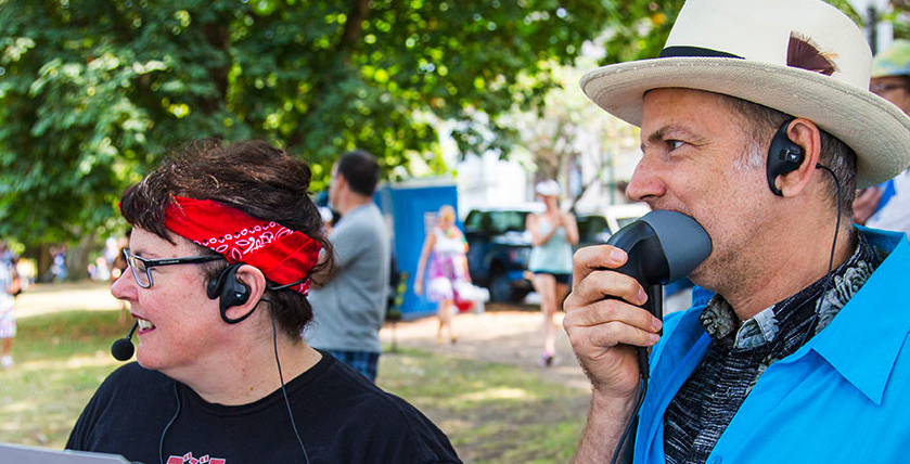 VocalEye audio describers at work. In addition to theatre, VocalEye also describes festival events like the Vancouver Pride Parade and Celebration of Light fireworks display. | Image: VocalEye.