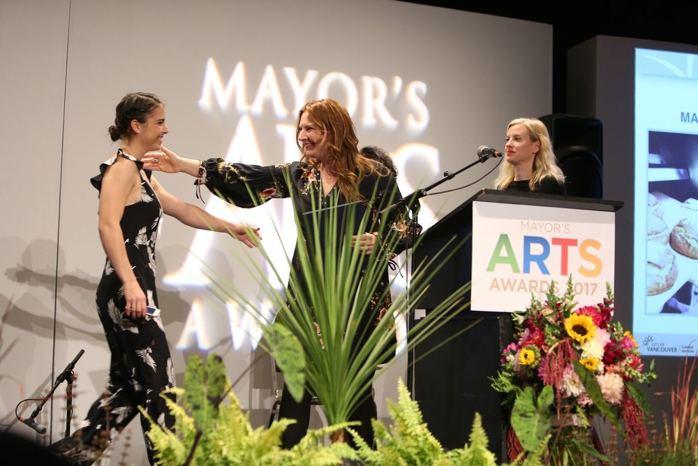Culinary Arts honouree Mary Mackay (centre) greets emerging artist Leah Patitucci (left) as they accept their awards. | Image: Sarah Race.