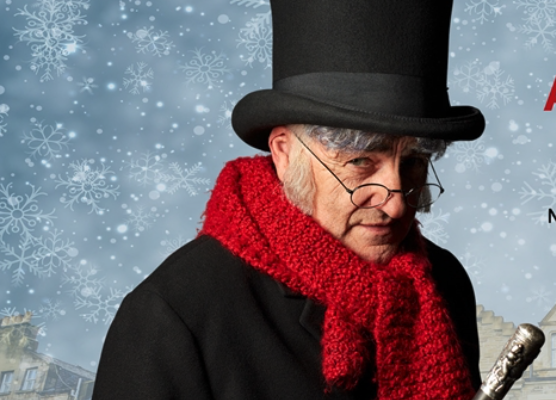 The miserable Ebenezer Scrooge (Michael Spencer-Davis) is taken on a transformative journey by three spirits—and one very unhappy ghost—in James MacDonald's new version of A Christmas Carol. | Image: Western Theatre Canada