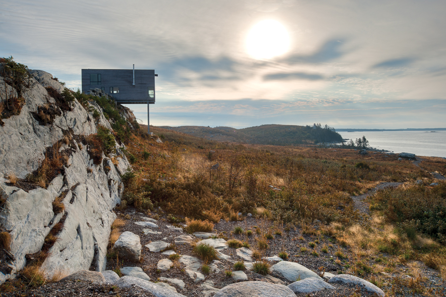 Intended as a repeatable prototype, Mackay-Lyons Sweetapple's  Cliff House  (2010) is a modest steel framed cabin perched precariously on a bedrock cliff. | Image: Greg Richardson.
