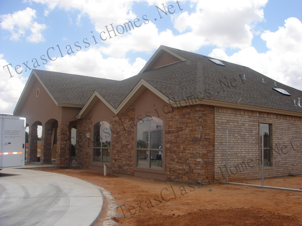 Stack stone, Brick and Stucco make a for a classy combination,
