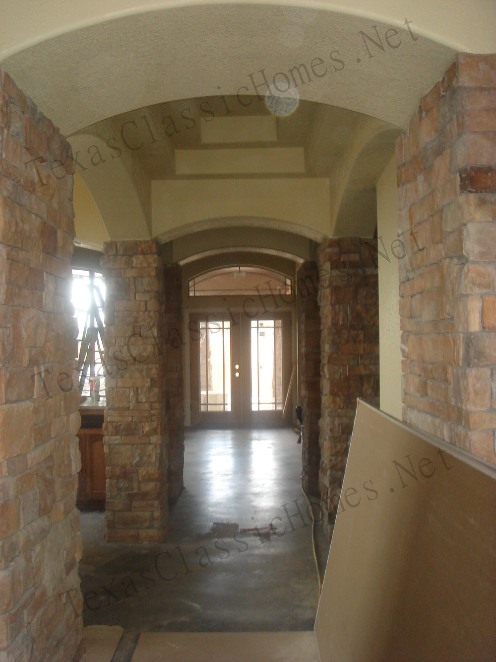 Interior Stone Columns and step ceilings make the Entry breathtaking.