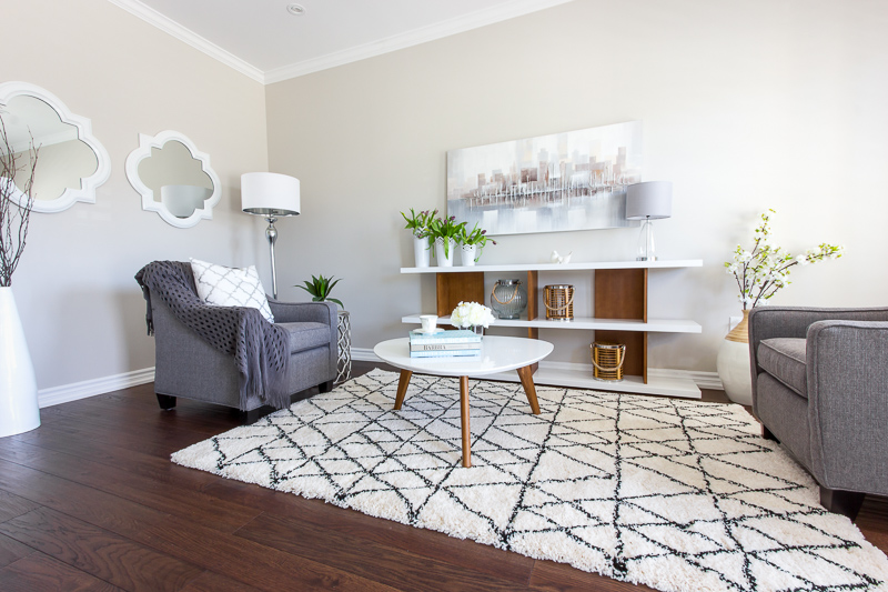 A cozy lounge room in Barrrie, staged and decorated by New Leaf Decor