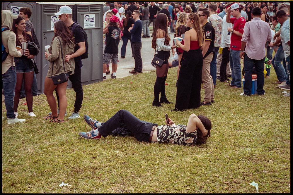 Man in Grass on Phone , Nikon F3 / Portra 400 (4) 1-27-18