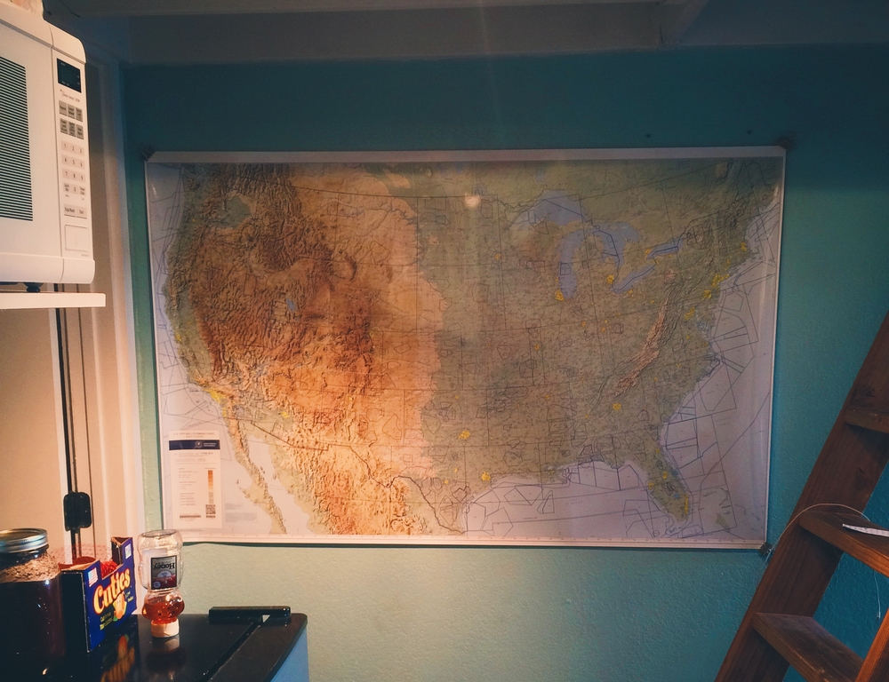 A flight planning chart hangs on my wall now. You can't see it in this shot, but there's a tiny little black dot in California. Walking by it some days, my eyes slowly scan east.