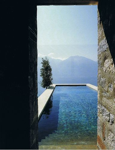 Poolside mountain views, Italy.