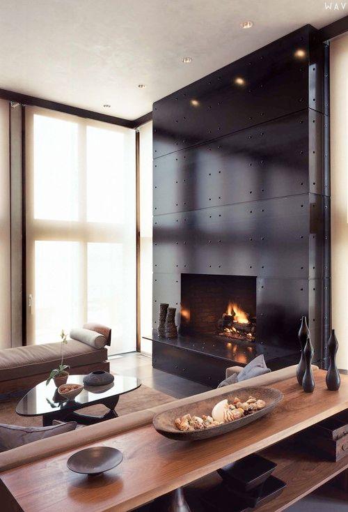 via milkboxes - metal rivit accented fireplace why.i.design