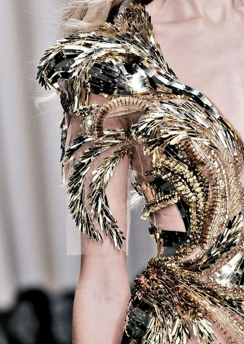 Fashion Gold... luxurious gold dress with an intricately structured, raised pattern; closeup couture; opulent fashion Valentin Yudashkin