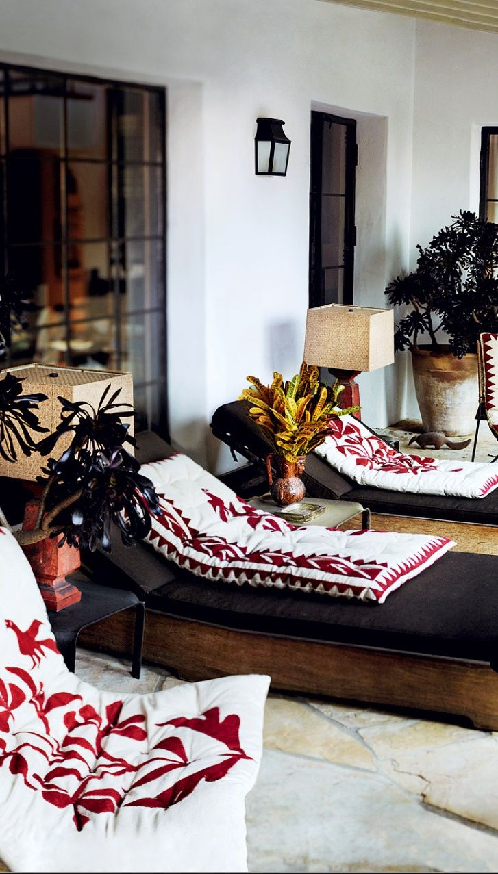Mario Testino's Los Angeles home featuring Mexican Otomi pattern embroidered outdoor lounge chair pillows photo via Beautiful Porches and Patios