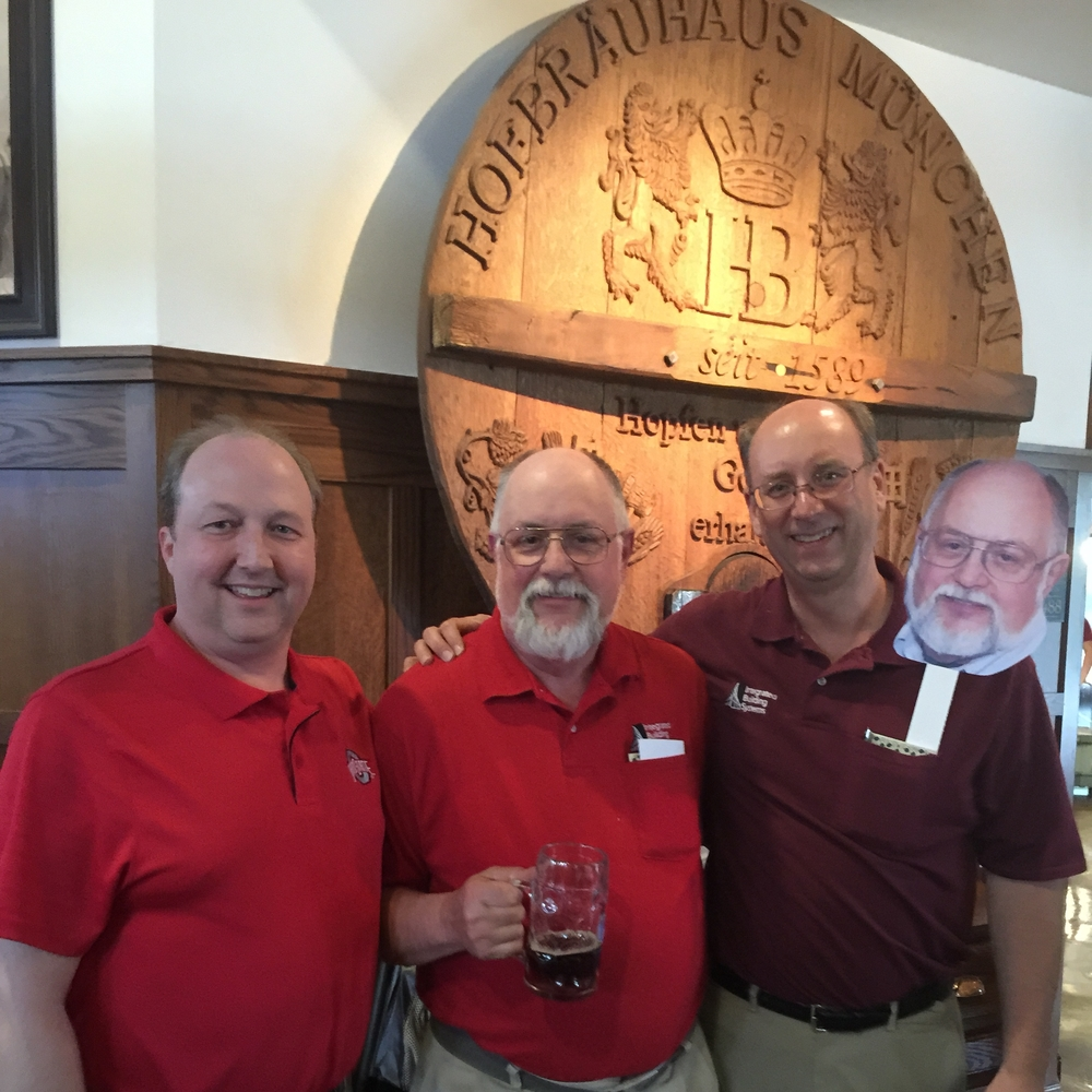 IBS celebrated Jim's retirement in fine German style at Hofbräuhaus Columbus. Left to right, Chip Chapman, IBS President; Jim; Bill Helland, IBS Vice President; and Jim on a Stick, a new celebrity at the restaurant.