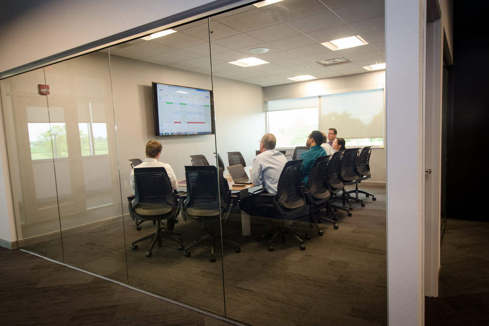 New audio-visual systems make team collaboration easier with large screens, in-ceiling microphones, and tabletop control systems.