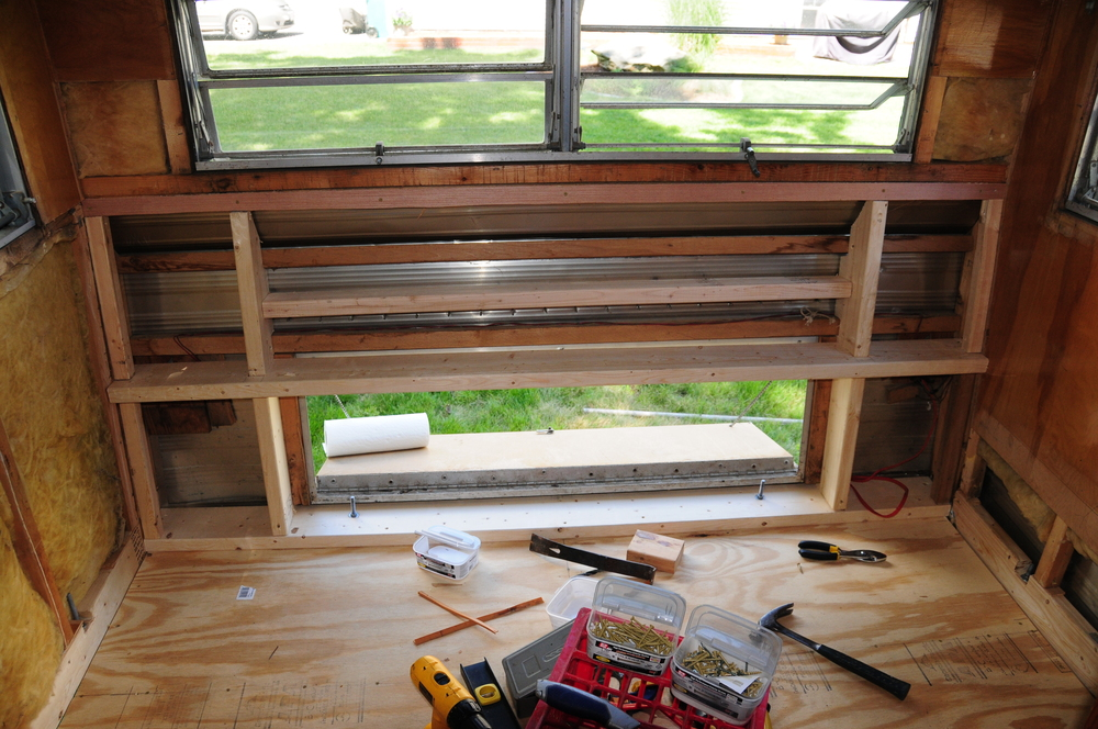More framing! We added a 2x4 across the top of the access opening. That member will support the bench framing. We re-used most of the wood from the original bench, just re-arranged it. We tried to make the back as strong as possible. We'll see how it holds up when the bumper garden goes on.
