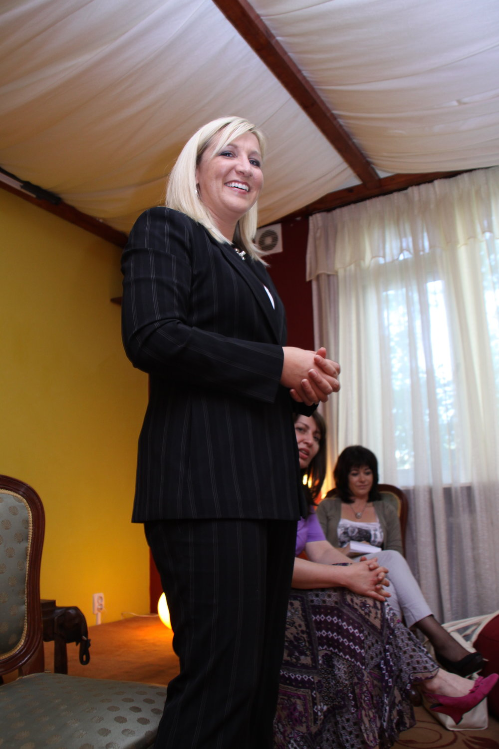 Tara giving a talk during a book launch in Romania