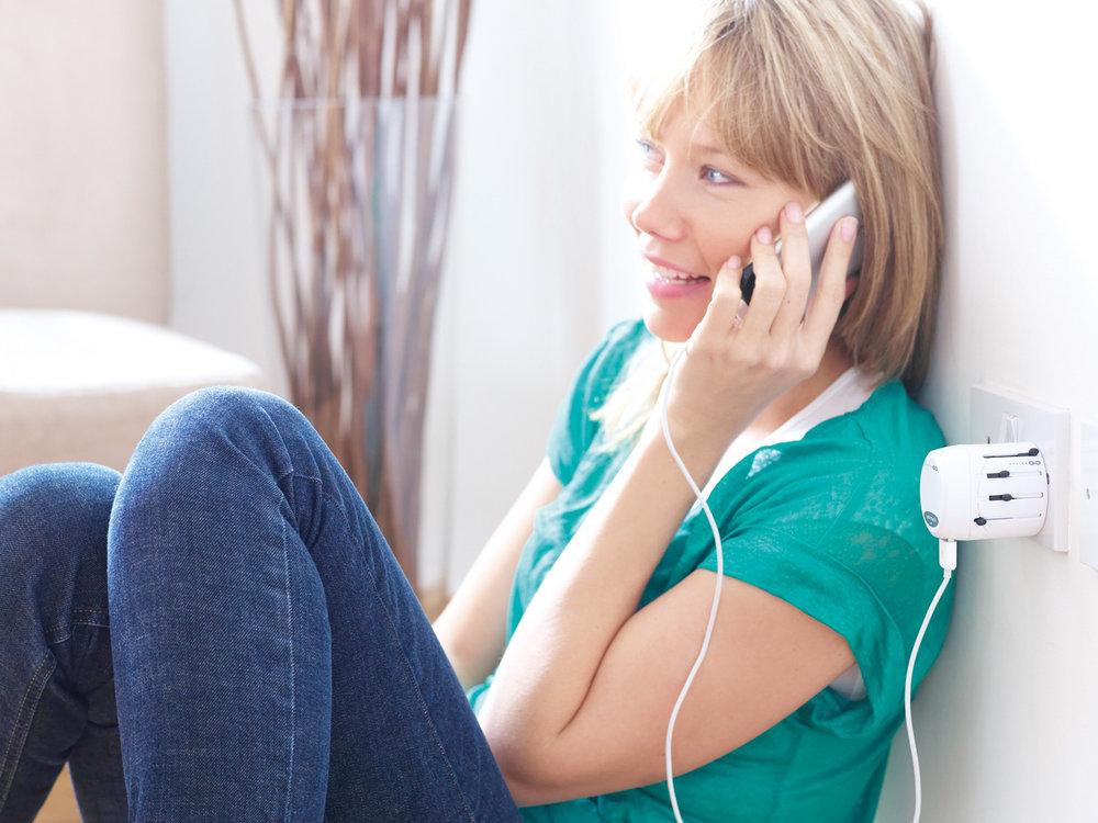 design_go_adapter_plugs_woman_talking_on_phone.jpg