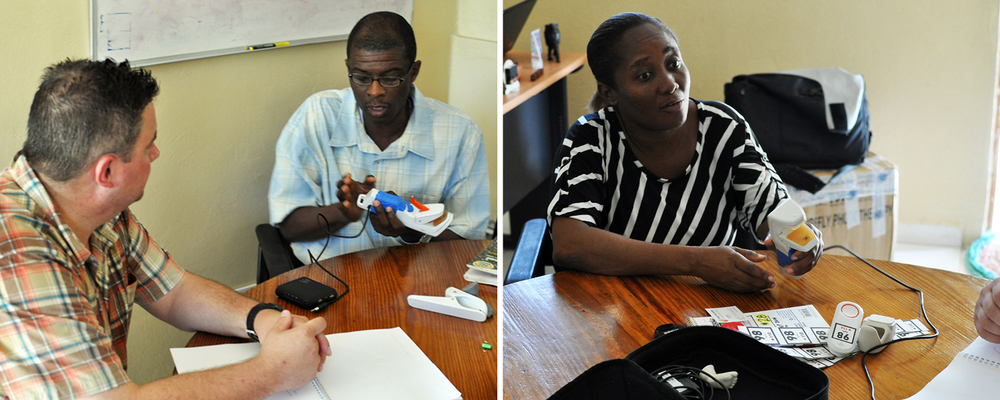 Tim asks Saint Boniface Hospital Director General Dr. Inobert Pierre (left) and Deputy Director Dr. Miliane Clermont (right) to try DtM's Pelican pulse oximeter prototypes.