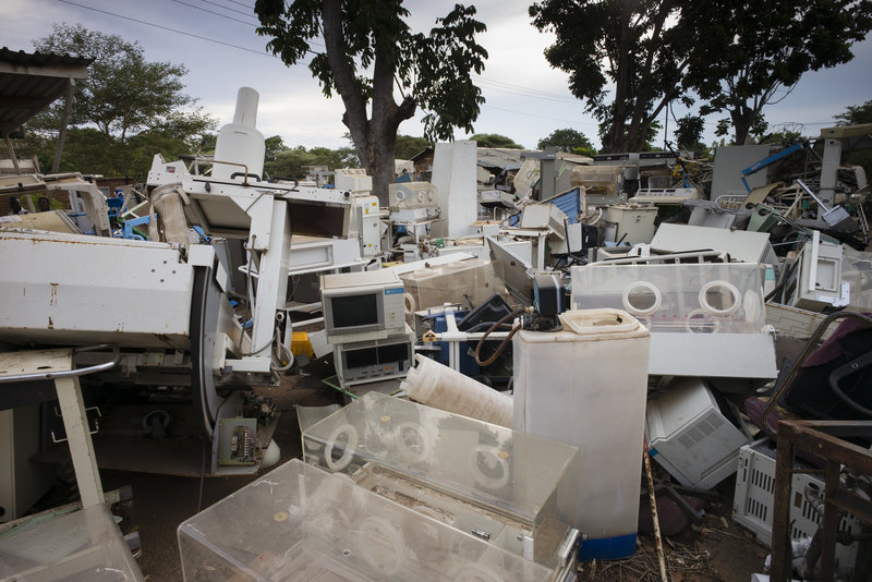 Piles of broken medical equipment outside a hospital in Mozambique.