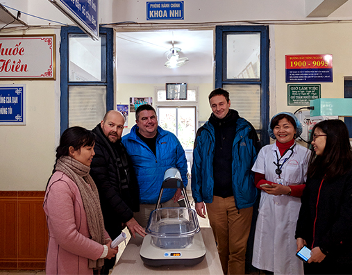 The Firefly team installing a new device at Thao Nguyen District Hospital in Moc Chau, Vietnam. From left, Hoi Nguyen and Luciano Moccia from Day One Health, Timothy Prestero from DtM, Greg Dajer from MTTS, Dr. Nguyen from Thao Nguyen Hospital and Hai Doan from MTTS.
