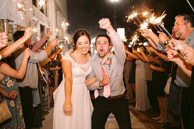 Now that's what I call a sparkler exit ✨ Have you ever wondered how to get a BOMB sparkler photo EVERY time? This past year I have sat and wondered how can I make this possible everyyyy time. By all means, this is just my opinion that works best for my style so take it as you wish :) Here's a few tips I've gathered this year to help make it amazing every time! . . BE. YOUR. SELVES! Enjoy it! You just got married so celebrate ! Have fun BUT yet be aware of your facial expressions!! What you do IS what will be captured. I can't emphasize this enough lol. Photogs..If you know, you know 😂🤷🏼‍♀️ . . Have longer sparklers that do not give off smoke. Make sure you do research on what you purchase. Last thing you want is you getting lost in a mist of smoke. Trust me. We can only do so much to salvage that. . . If you want the sparklers to be seen, have a narrower path BUT enough space to feel comfortable. When it's so far apart you can lose the beauty of the sparkler magic which is GOLDEN. I feel like this is key to getting that perfect look if your wanting to get tighter shots. . .  COUPLES: If you decide to give your girl a dip for a kiss please please please make sure you don't dip her backwards. If you dip her sideways, you can see yalls sweet faces and make for a great shot. Remember, practice makes perfect so if that means practicing before yalls big day, go for it. It'll be worth it🤗 . . Photogs: Make sure them batteries are freshhhh! Last thing you need is your flash lagging because they are dying on you and then you risk missing a moment. . . Lastly....DO. NOT. RUN 😬 I know you may be sooooo excited to roll out buuuut for the photographers.. it's dark which means harder to catch focus especially when your running. So if you can slowly glide through as your friends and family send you off.. you will not only be our best friends but we will get you what you have imagined and dreamed of. . . I'm sure there are plenty more but If I missed any more tips, please let me know what others you feel like have helped you achieve your dream sparkler photos!