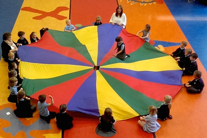Using a 'parachute' is a great way of allowing small children learn how to share and help one another - it's also great fun!