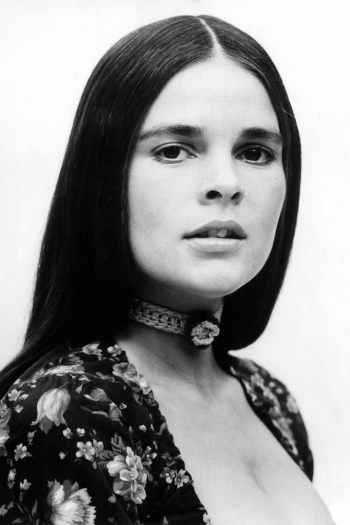 Ali Macgraw in woven choker and floral.