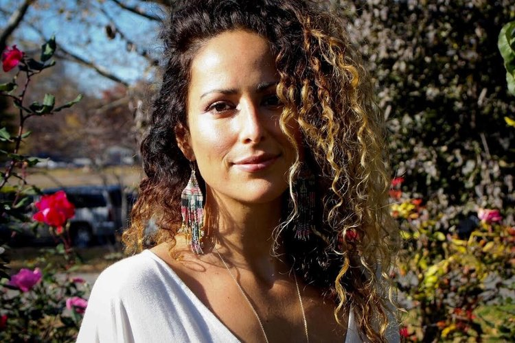 Nicole Adriana Casanova, Soul Architect, a 200 RYT Yoga Alliance certified, a certified Reiki Master in the Usui and Karuna Reiki Riojo, a Human Movement and Meditation teacher, and Magical Awakening Practitioner.