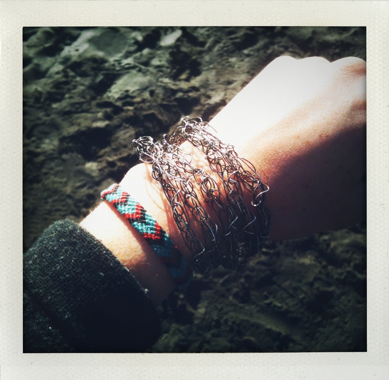 Photo by  CLo !    dusseau :     Crocheted silver wire wrap by Dusseau   Hand-knotted friendship bracelet by  Hannah Suzanna