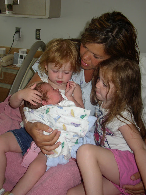 My daughters meeting my firstborn son Ethan
