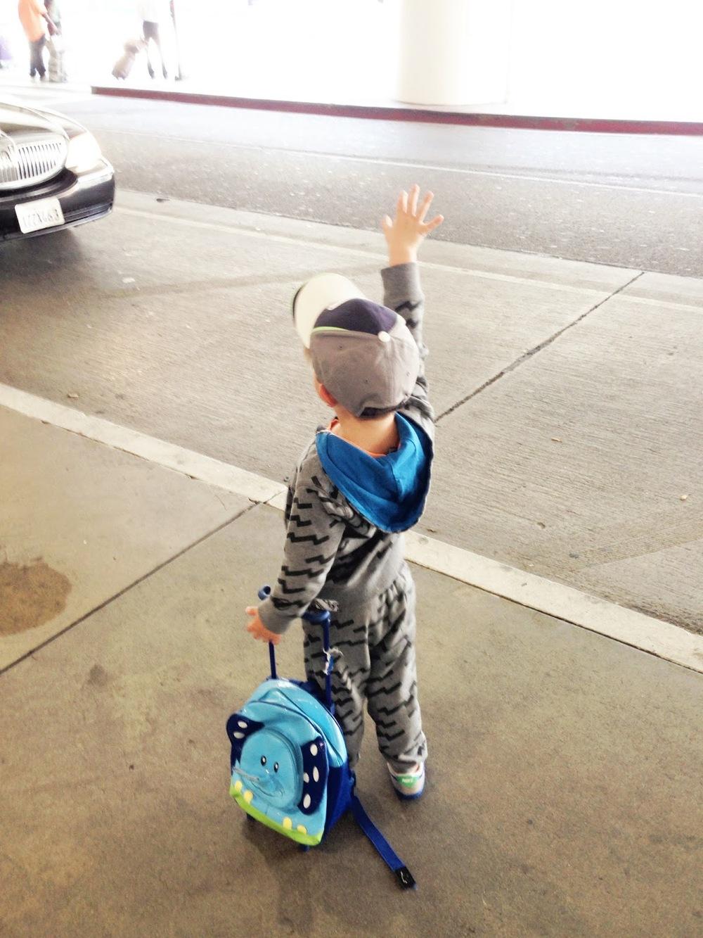 My son Zeke hailing a cab for Disneyland