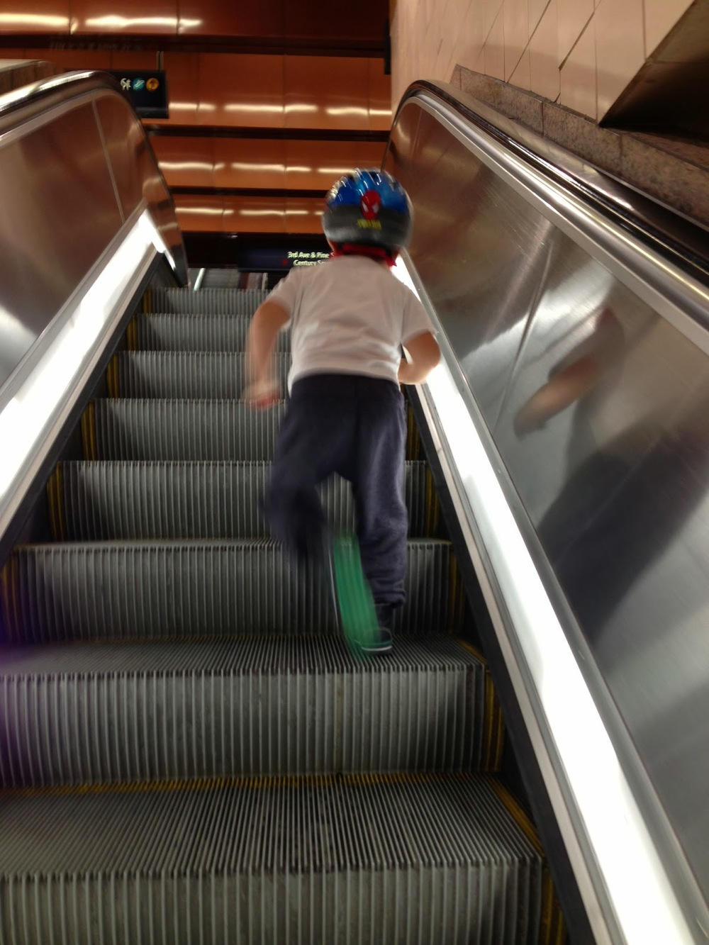 Even an escalator is fun when you're three!