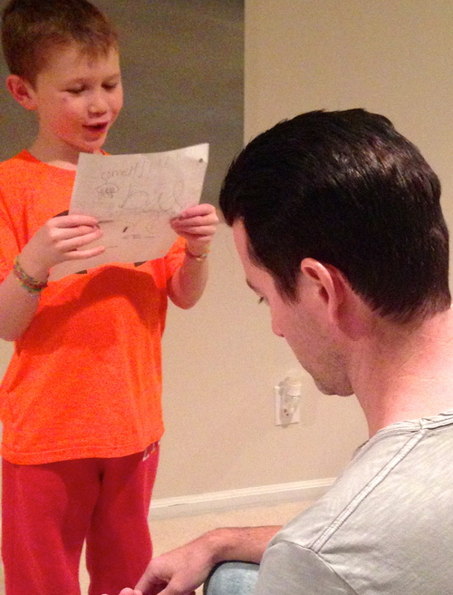 Ethan reading his list to Elijah