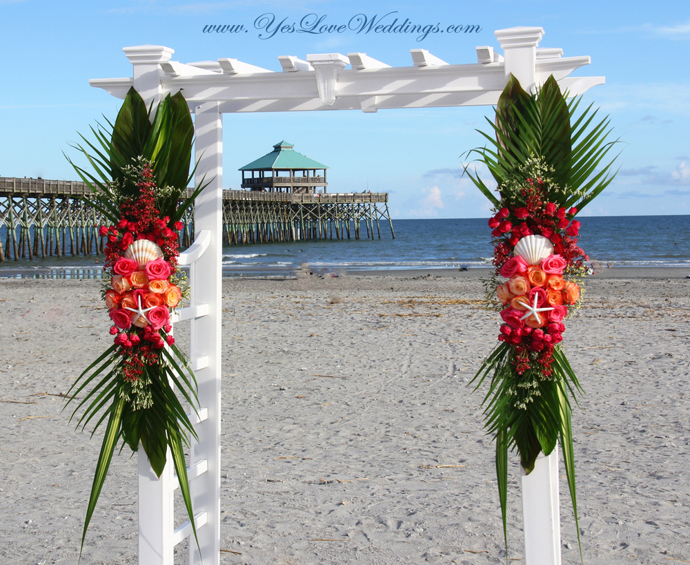 Folly Beach Charleston SC Tybee Island Savannah GA Hilton Head SC Beach Wedding Wedding arch with tropical flowers