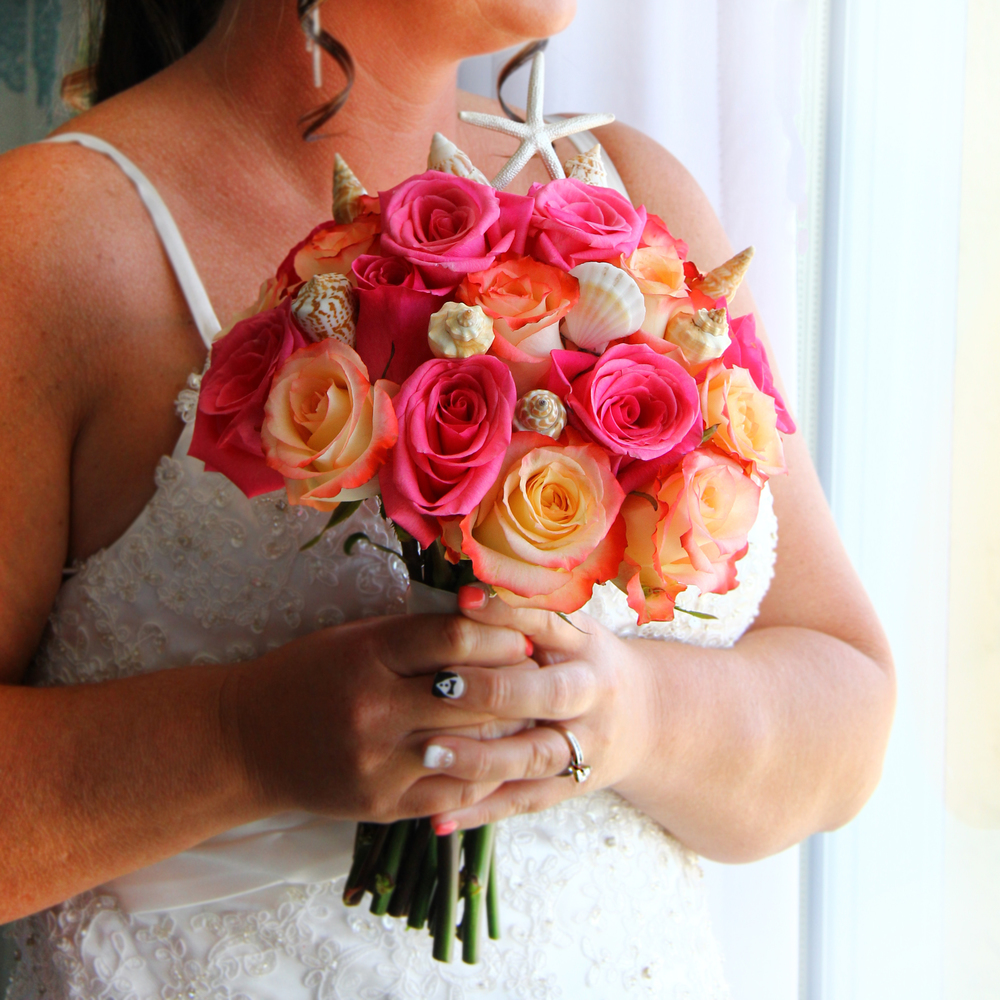 Beach wedding bride's bouquet with roses and seashells, starfish Folly beach, Tybee Island, Hilton Head