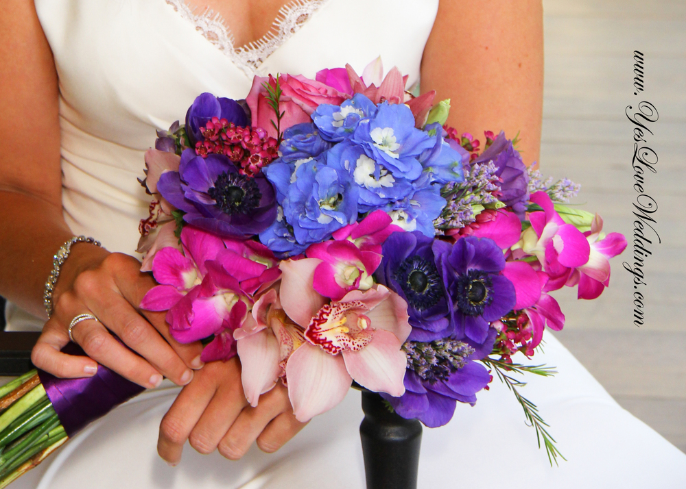 Bride's Bouquet in Blues, Purples and pinks with orchids, Anenome, delphinium, colorful Savannah, GA wedding