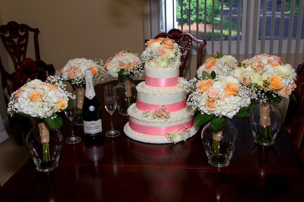 Pink Wedding flowers and cake