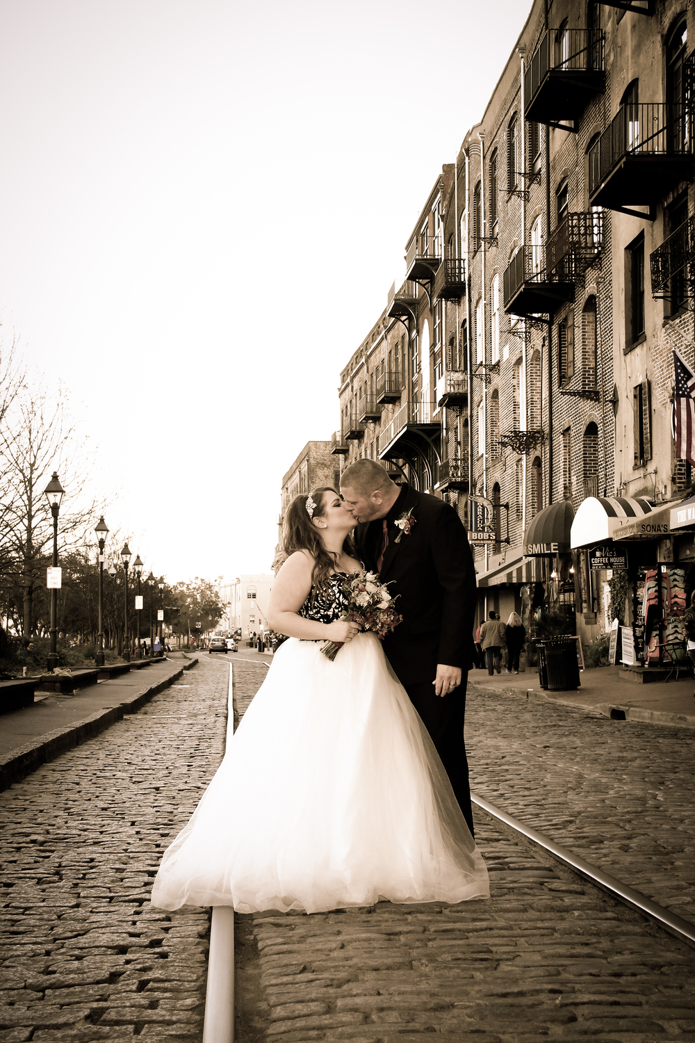 Savannah Wedding River Street kiss